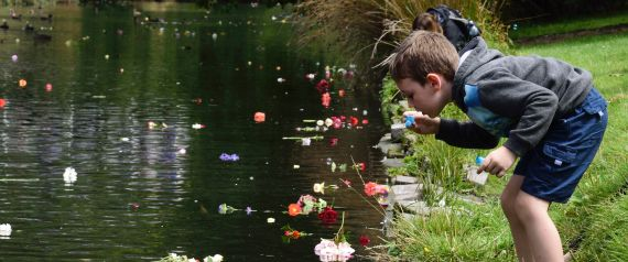 Children blow bubbles next to the Avon river at the Botanical Gardens in memory of those lost in the 2011 Christchurch earthquake during the fifth anniversary of the Christchurch earthquake in Christchurch on February 22, 2016. AFP PHOTO / MARTY MELVILLE / AFP / Marty Melville        (Photo credit should read MARTY MELVILLE/AFP/Getty Images)